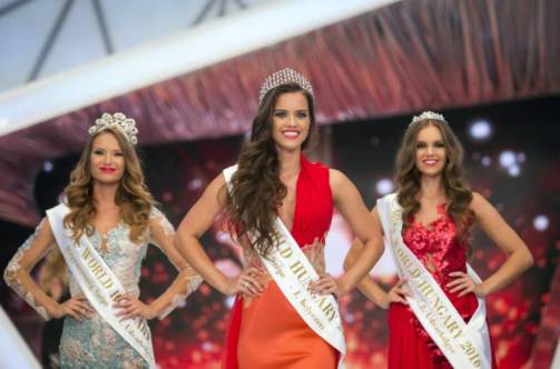 From left: Second placed Eszter Oczella, winner Timea Gelencser and third placed Babett Dukai, pose on the stage during the final of the Miss Hungary beauty pageant, in Budapest