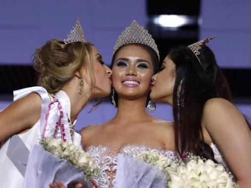 Miss Philippines Trixia Maria Maraña is kissed by her two runners-up, Miss Belarus and Miss India, after being crowned Miss Asia 2016 on Thursday.