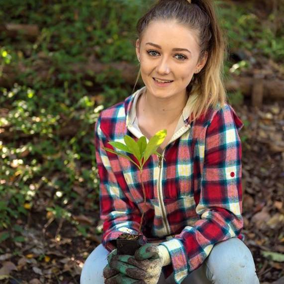 Miss Earth Australia 2017 candidate planting trees